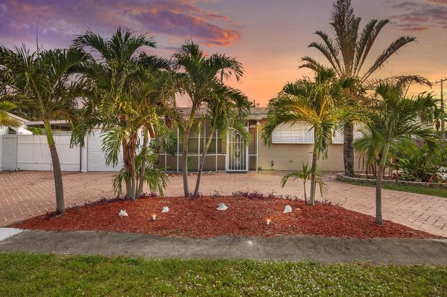 108 Cayman Drive Dr, Palm Springs, FL 33461