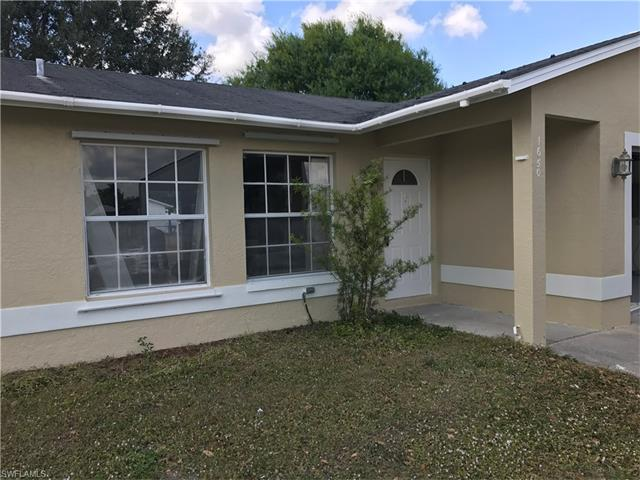1650 Cheshire Circle W, Lehigh Acres, FL 33936